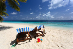 Two chairs on the tropical beach Stock Photography