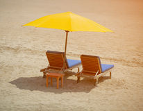 Two chairs on a tropical beach Royalty Free Stock Photo