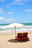 Two Chairs and Umbrella. At Beach Stock Image