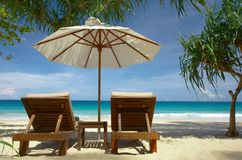 Two chairs and umbrella royalty free stock image