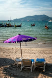 Two chairs and umbrella on the beach Stock Photography