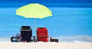 Two chairs and umbrella on stunning tropical beach Royalty Free Stock Images