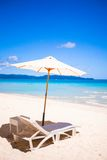 Two chairs and umbrella on stunning tropical beach Stock Image