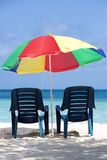 Two chairs and umbrella on tropical beach, venezuela Stock Image