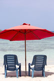 Two chairs and umbrella on tropical beach, venezuela Stock Photography