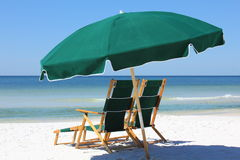 Two chairs and umbrella on white sand beach Stock Photo