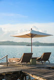 Two chairs and umbrella on wooden desk in resort ,Phuket Stock Photography