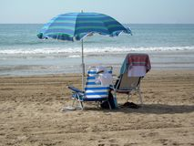 Two chairs under one umbrella Royalty Free Stock Photo