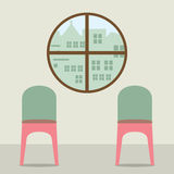 Two Chairs Under Round Window Royalty Free Stock Image