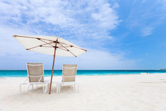 Two chairs under umbrella Royalty Free Stock Images