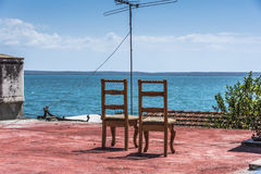 Two chairs with view onto the sea stock images