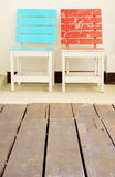 Two chairs on white wall Stock Image