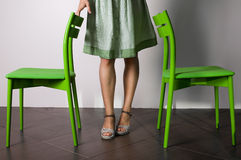 Two chairs and woman legs Stock Photography