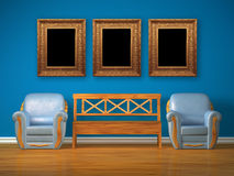 Two chairs with wooden bench and antique frames Stock Image