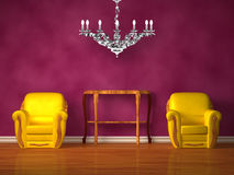 Two chairs with wooden console and chandelier Stock Photo