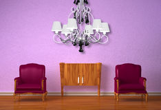 Two chairs with wooden console and chandelier Royalty Free Stock Photo