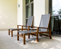 Two chaise longue on balcony Stock Photos