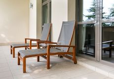 Two chaise longue on balcony Stock Image