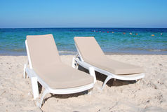 Two chaise-longues on the beach Royalty Free Stock Image