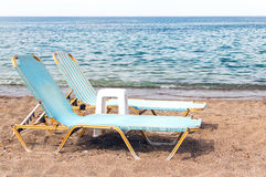 Two chaise longues on the beach Royalty Free Stock Photo