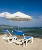 Two Chaise Lounges on Beach Royalty Free Stock Photos