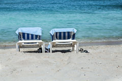 Two Chaise Lounges on Beach Stock Image