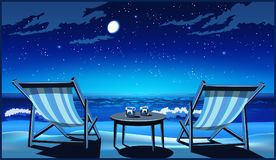 Two chaise lounges on the beach at night. Two chaise lounges, glasses of whiskey on the seashore at night Royalty Free Stock Images