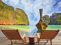 Two chaise lounges and small table on the beach Royalty Free Stock Photography
