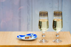 Two champagne flute filled with champagne. Stock Photos