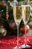 Two Champagne Flutes on Christmas Background Stock Images