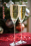 Two Champagne Flutes on Christmas Background Royalty Free Stock Images