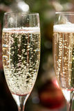 Two Champagne Flutes on Christmas Background Stock Photo