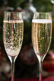 Two Champagne Flutes on Christmas Background Royalty Free Stock Photography
