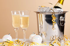 Two Champagne flutes and ice bucket Royalty Free Stock Images
