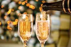 Two Champagne Glass On Defocused Background. Living Room With Christmas Tree Stock Photography