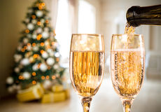 Two Champagne Glass On Defocused Background. Living Room With Christmas Tree Royalty Free Stock Photo