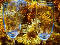 Two champagne glasse close up. Champagne glasses close up, garland tinsel in the background royalty free stock photography