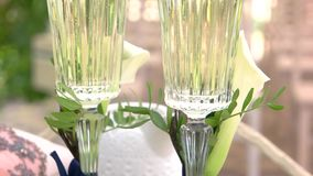 Two champagne glasses. Beverage with small bubbles. Drink for bride and groom stock footage