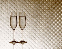 Two champagne glasses on blurred checkered background Stock Photos