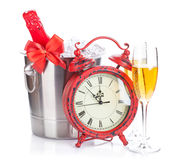 Two champagne glasses, bottle in cooler and clock Stock Photo