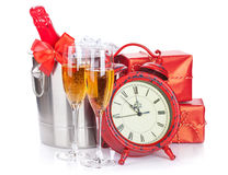 Two champagne glasses, bottle in cooler and clock Royalty Free Stock Photography