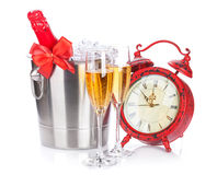 Two champagne glasses, bottle in cooler and clock Royalty Free Stock Image
