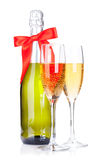 Two champagne glasses and bottle with ribbon Royalty Free Stock Photo