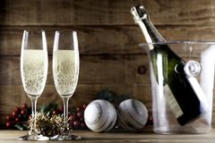 Two champagne glasses with champagne bottle and ice bucket Stock Photos