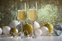 Two champagne glasses and christmas balls Stock Photo