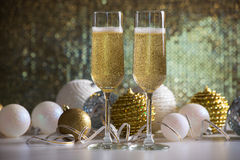 Two champagne glasses and christmas balls Stock Images