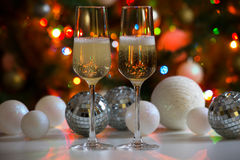 Two champagne glasses and christmas balls Royalty Free Stock Image