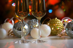 Two champagne glasses and christmas balls Royalty Free Stock Photography