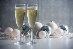Two champagne glasses and christmas balls Stock Image