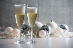 Two champagne glasses and christmas balls Royalty Free Stock Photo